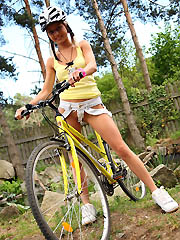 18yo schoolgirl Pinky June riding bicycle..