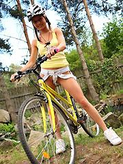 18yo schoolgirl Pinky June riding bicycle..