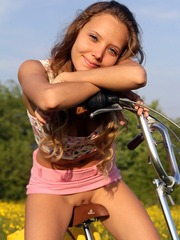 Little teen sunny riding a bicycle without panties
