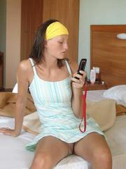 Hot sexy teen girls playing with cell phones and..