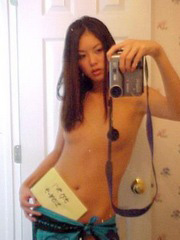 Skinny naked Japanese with small tits and a..