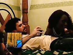 Afro temptress giving oral sex to a white tourist